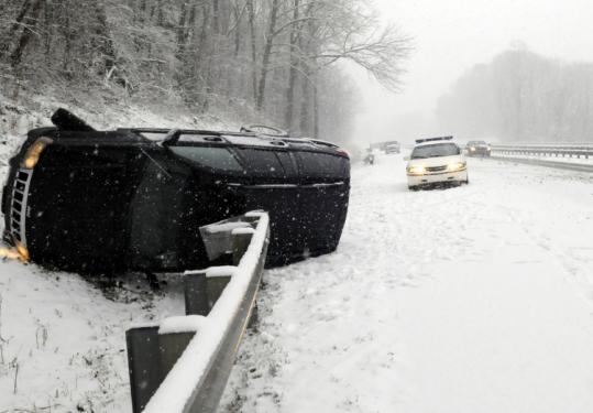 A sport utility vehicle landed in a ditch along Interstate 40 in North Carolina. Much of the state was under a storm warning.