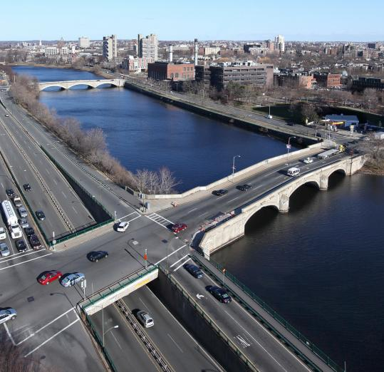 State transportation officials concluded it is not feasible to add underpasses during the reconstruction of three bridges over the Charles River, but advocates and legislators are asking them to reconsider.