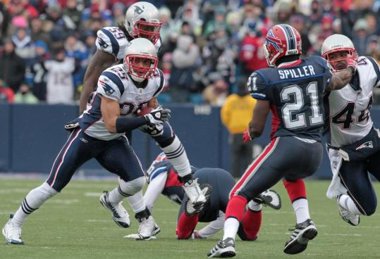 Patriots safety Patrick Chung (left) returns the first of Bills quarterback Ryan Fitzpatrick's three interceptions to the Buffalo 27-yard line. A short time later, New England had a 24-3 lead.
