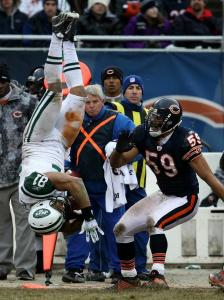Jets tight end Dustin Keller took to the air after a hit by the Bears' Pisa Tinoisamoa, but was able to hang on for the catch and a first down.