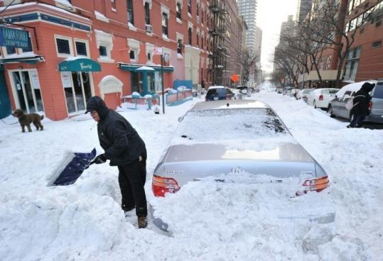 The storm dropped 18 to 20 inches of snow on New York City, clogging streets such as this one on the east side of Manhattan.