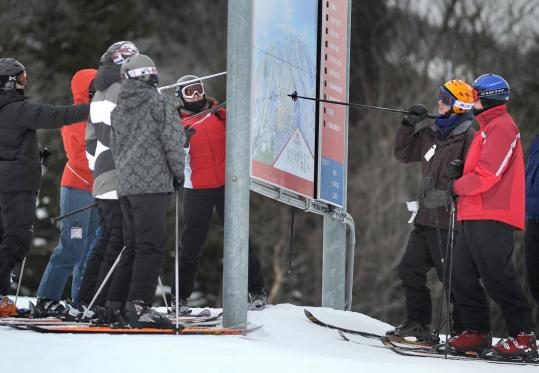 At Sunday River in Maine, skiers plotted their trail strategy on Sunday. The snowfall is good news for New England's ski resorts.
