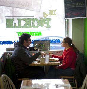 Eddie Kennedy and Ashley Fairbank of Waltham enjoy the cheerful ambience at In a Pickle.