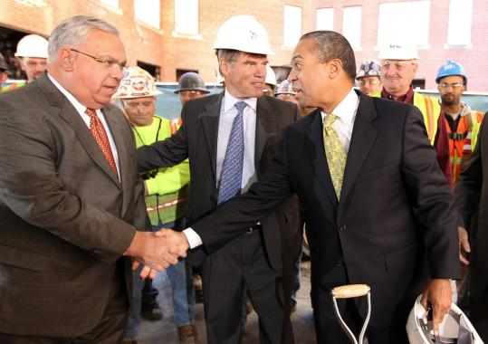 Mayor Thomas M. Menino (left) joined Liberty Mutual CEO Edmund F. Kelly (center) and Governor Deval Patrick at an October groundbreaking. The insurer won a $22.5 million state tax break for the project.