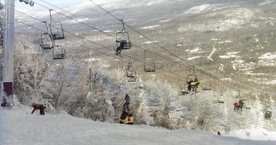 A skier was helped down from a chairlift after the lift derailed on the state's tallest ski mountain at the Sugarloaf resort in Maine.