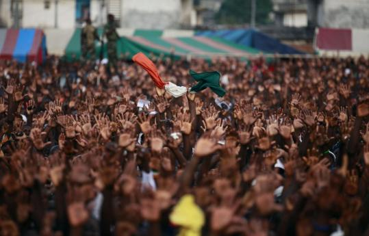 Supporters of Ivory Coast's incumbent leader Laurent Gbagbo, who refuses to hand over power, held a national flag aloft yesterday during a rally in a section of Abidjan, the financial capital.