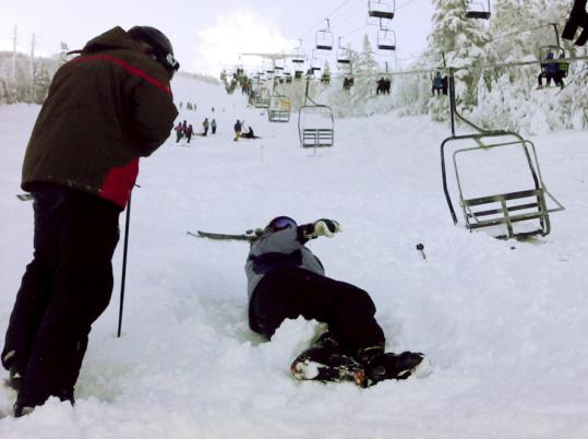 A passing skier waited with one of the eight people injured Tuesday when a chair lift derailed and sent several cars plunging about 30 feet to the ground at the Sugarloaf ski resort in Maine.