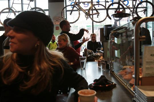 Maureen Bruno (left) of Arlington socializes at Ride Studio Café in Lexington, where the choices include coffee, bicycles, and conversation.