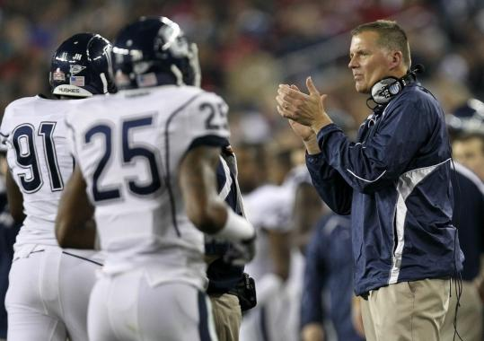 Randy Edsall encourages his players at the Fiesta Bowl, his final game as UConn coach.