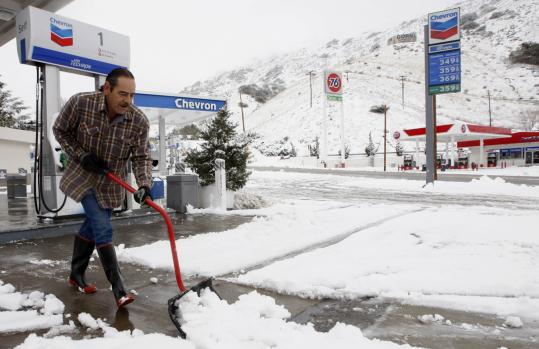 Daniel Diez shoveled snow in Gorman, Calif., yesterday, nearly 24 hours after a storm paralyzed roads in Southern California.
