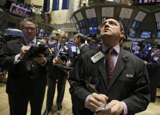 As traders worked at the New York Stock Exchange, better news on the economy lifted stocks.