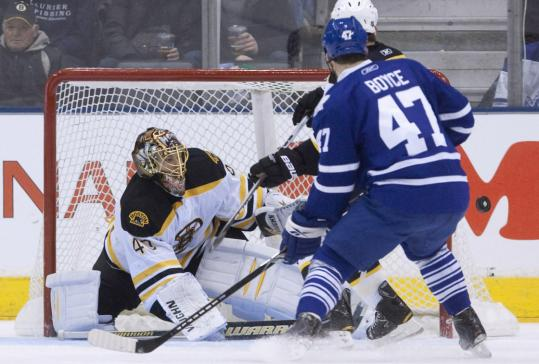 Bruins goaltender Tuukka Rask stops a Darryl Boyce attempt, one of his 36 saves in Toronto.