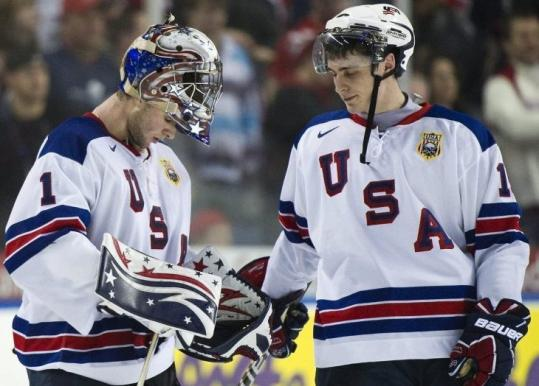 Chris Kreider consoles goalie Jack Campbell following Team USA's 4-1 loss to Canada in the semifinals.