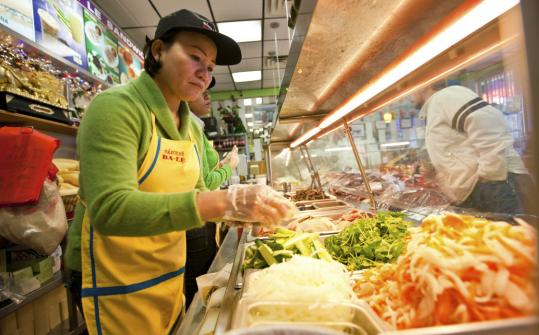 Jennifer Nguyen, a native of Vietnam, makes banh mi at her shop, Banh Mi Ba Le, in Dorchester.
