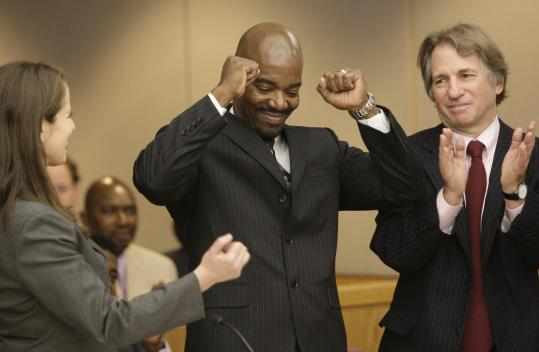 Cornelius Dupree Jr. (center), celebrating with lawyers yesterday, served 30 years before DNA evidence proved him innocent.