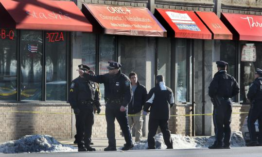Boston police in the area along Blue Hill Avenue where one man was fatally shot yesterday afternoon.