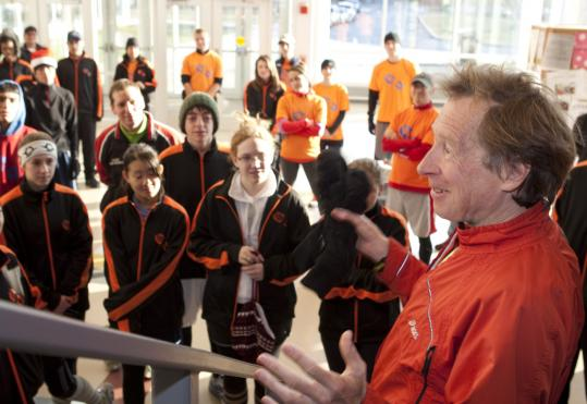 Bill Rodgers addresses members of Dreamfar before joining them for a 6-mile outing along the Boston Marathon route in Newton.