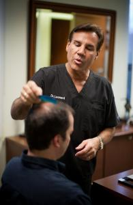 Dr. Robert Leonard consults with a patient at his office in Newton.