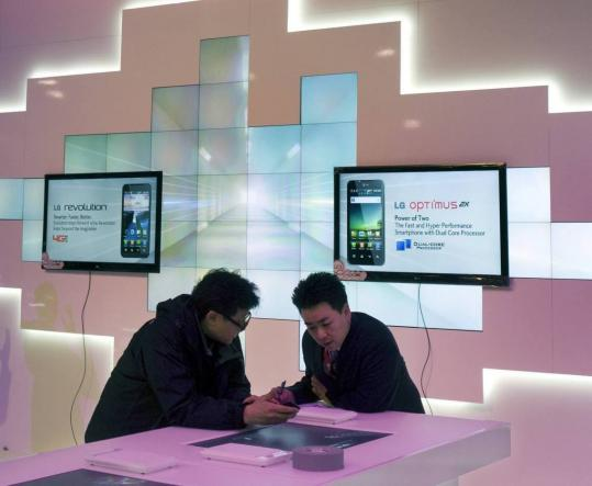 Workers at the LG Electronics booth went over last-minute preparations yesterday on the eve of the 2011 Consumer Electronics Show opening in Las Vegas.