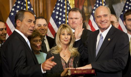 William R. Keating (right), Democrat of Massachusetts, took part in a ceremonial swearing-in to the House yesterday with Representative John Boehner, the new speaker. Keating's wife, Tevis, held the Bible for the Capitol Hill event.