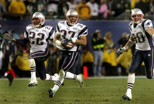 2004: Three out of four Corey Dillon was the new weapon for the Patriots. The veteran running back piled up a franchise-record 1,635 yards and scored 12 touchdowns. Tom Brady threw for almost 3,700 yards, completing more than 60 percent of his passes to receivers like David Patten, David Givens, and Daniel Graham, in addition to Deion Branch. All-Pro defensive lineman Richard Seymour, linebackers Tedy Bruschi, Mike Vrabel,and Willie McGinest, and defensive backs Ty Law and Rodney Harrison (pictured) were part of one of the toughest defenses in the NFL. The Patriots finished at 14-2 for the second straight season to win the AFC East.