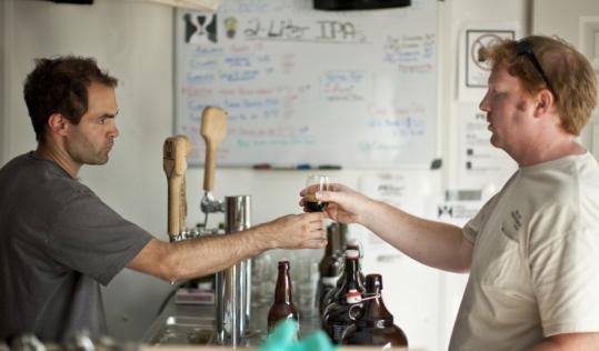 At Hill Farmstead Brewery, Shaun Hill, the brewer, offers a visitor a sample.