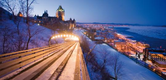 Dufferin Terrace, built in 1838 next to Fort Saint-Louis, overlooks the St. Lawrence River. Château Frontenac lights up the hill. Below, an ice hotel, and a snowboarder at Stoneham, the closest good-sized ski area to Québec City.