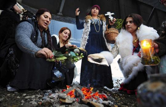 Romanian witches gathered around a fire to celebrate Epiphany while others cursed the government for having to pay taxes.