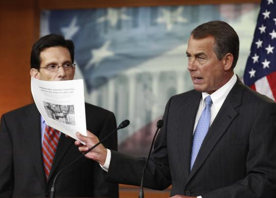 House Speaker John Boehner held a copy of a proposal to repeal the health care law during a press conference yesterday. His office gave no indication whether he would back a repeal of the financial overhaul law or support a less drastic approach.
