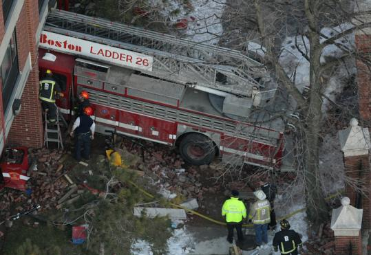 Insurers of the Huntington Avenue building hit by a runaway Boston firetruck in January 2009 are suing for $410,000.
