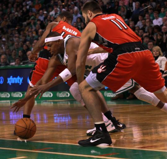 Paul Pierce scrambles for a loose ball between Toronto's DeMar DeRozan and Linas Kleiza.