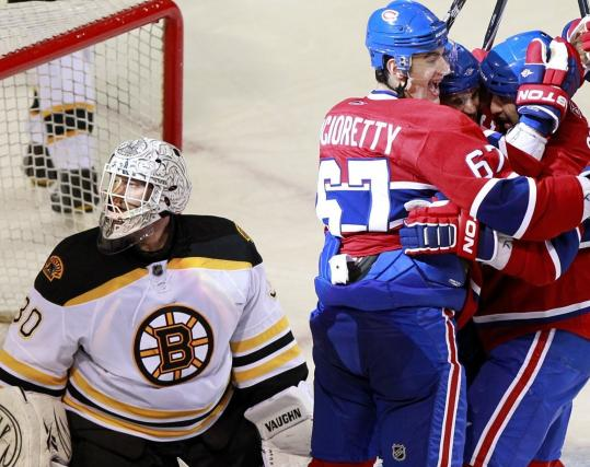 Christinne Muschi/REUTERS Montreal's Brian Gionta (right) is mobbed by Max Pacioretty and his mates after tying the game with 48 seconds to play . . .
