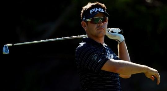 Louis Oosthuizen follows his tee shot on the 18th hole during third-round play at the Africa Open. He is tied for the lead.
