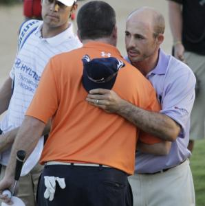 Jonathan Byrd (right) greets Robert Garrigus after winning the Tournament of Champions on the second playoff hole.
