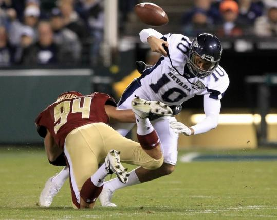 Nevada quarterback Colin Kaepernick fumbles after being blasted by a hit from BC linebacker Mark Herzlich. The Eagles recovered, leading to their only TD and a 7-0 lead.