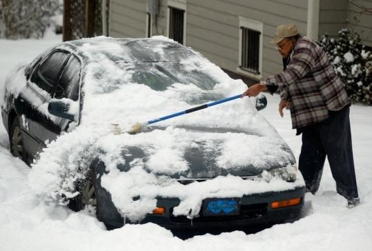 People in regions unaccustomed to heavy snowfall, such as Asheville, N.C., struggled to clean up after Sunday's storms.
