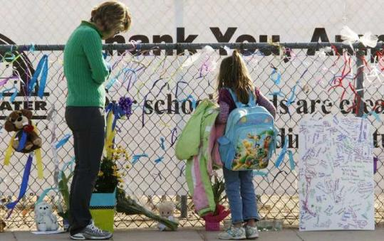 A memorial for Christina Green stood outside Mesa Verde Elementary school, where the shooting victim was a student.