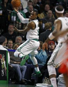 Rajon Rondo takes flight to save a loose ball near the Rockets bench in the first half. Rondo committed five of the Celtics' 13 turnovers, though he did have 12 assists and 9 points.