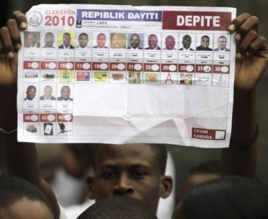 A demonstrator shows a marked election ballot during a protest against the November election results in Port-au-Prince.