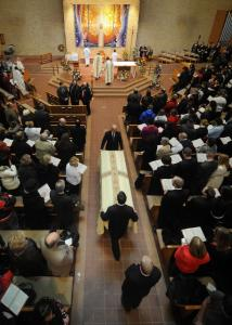 Pallbearers carried a casket containing the body of Millard South High School assistant principal Vicki Kaspar yesterday at St. Wenceslaus Catholic Church in Omaha.