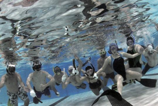Members of the UMass Lowell underwater hockey team are making a splash in a relatively new sport - underwater hockey.