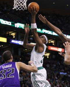 Celtics forward Paul Pierce slices to the basket in the second quarter for a hoop and a foul on the Kings&#8217; Francisco Garcia.