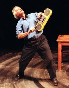 """And Everything Is Going Fine'' distills hours of footage of Spalding Gray (shown performing at Lincoln Center in 1999) on stage with just a few props and his wit."