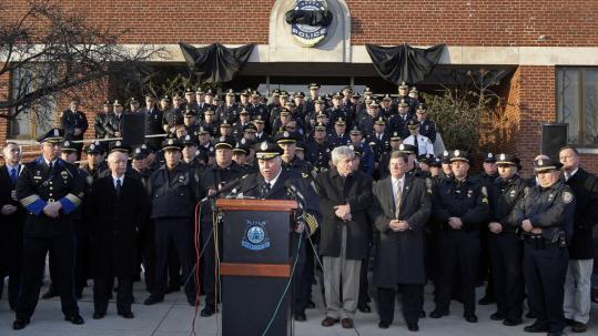Woburn's police chief, Philip L. Mahoney, spoke at a press conference last week on the front steps of the city's Police Department about reaction to the killing of Officer John B. Maguire.