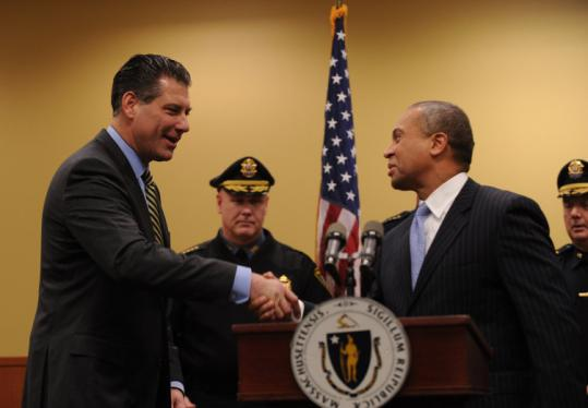 Governor Deval Patrick lauded the work of Peter Koutoujian (left) as a legislator, victim's advocate, and prosecutor.