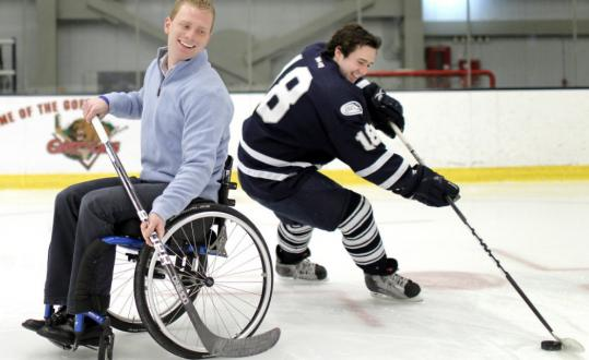 Tucker Mullin (right) and his friend, Tommy Smith, play a bit with a hockey puck.