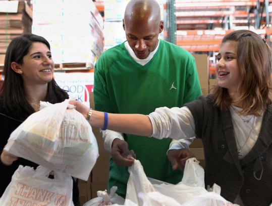 Ray Allen of the Boston Celtics joined volunteer Naris Ghazarians and eighth-grader Sophie Bernard of Dunstable during Project 351, a day of teen service, at the Greater Boston Food Bank.
