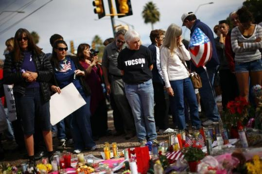 Well-wishers left tributes to Representative Gabrielle Giffords yesterday outside her office in Tucson. Doctors said that they might soon know if the injured legislator is able to speak.