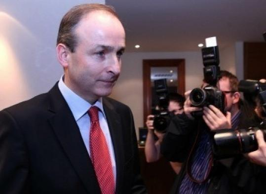 Irish Foreign Minister Micheal Martin, in Dublin yesterday, could be voted in to replace the prime minister.