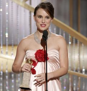 Golden Globe winner Natalie Portman holds her award last night in Los Angeles.